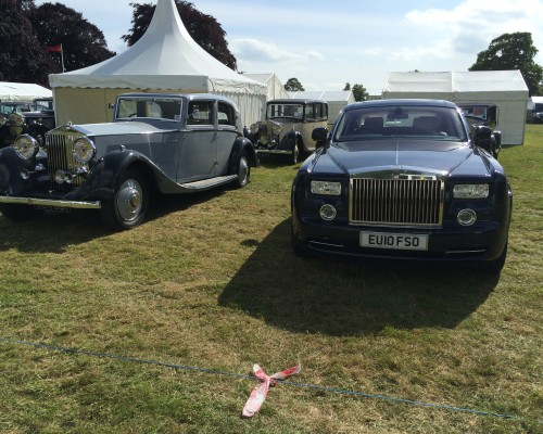 An image of vintage and new Rolls Royce parked next to a new Rolls Royce in front of various small marquees supplied by Big Top Marquees