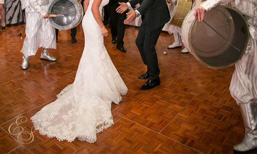 An image showing a bride and groom dancing at a wedding on a wooden floor in Bedfordshire