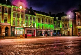 An image of the centre of Northampton town, lit up during the evening.