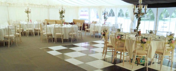 An image of a Wedding Marquee floor and chequered dance floor.