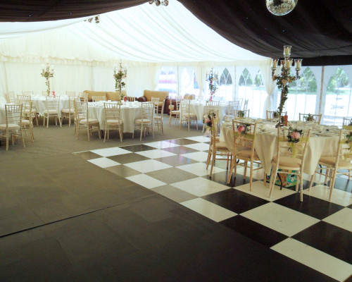 An image showing a Wedding Marquee hired from Big Top Marquees with dance floor in Northampton