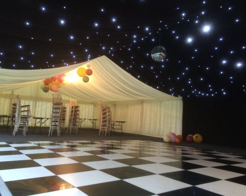 An image of a marquee with starlight lighting that has been designed by Big Top Marquees.