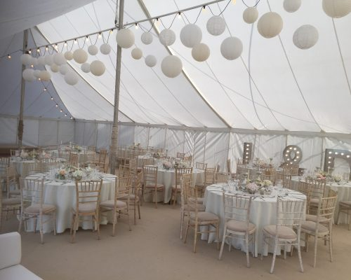 An image of white marquee decor, complete with paper lanterns that has been designed by Big Top Marquees.