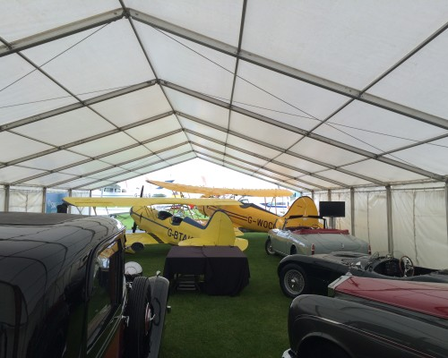 An image of a vintage car event held under an open marquee, supplied by Big Top Marquees.