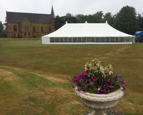 An image of a large white traditional marquee erected in an open field Bedfordshire.