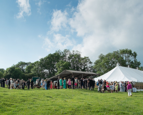 An image showing a wedding party inside a marquee from Big Top Marquees