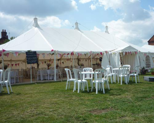 An image showing a traditional open marquee with furniture hire in Northampton