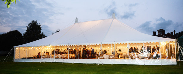 An image of a large party marquee illuminated by fairy lights