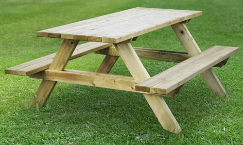 an image of a wooden Picnic Bench on a patch of grass