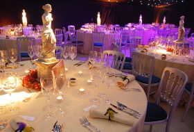 an image showing a decorated marquee with fairy lights and table settings