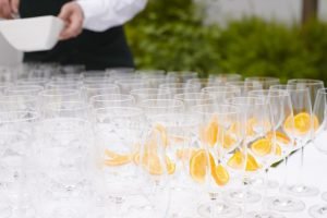 An image showing a table with multiple drinks glasses